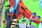 QUEENS - OCTOBER 7: Artist works at Five Pointz, an outdoor exhibit space featuring numerous graffit