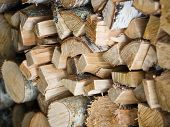 Background Of Pile Or Stack Of Chopped Wooden Logs.