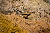 An open pit diamond mine in Botswana with heavy machinery on site. poster