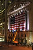 NEW YORK CITY - MAY 26: Crane workers adjust the large New York Stock Exchange flag May 26, 2010 in