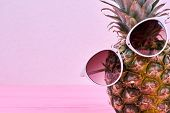 Funny Pineapple In Sunglasses And Copy Space. Ananas In Stylish Sunglasses And Text Space. Summer Tr poster