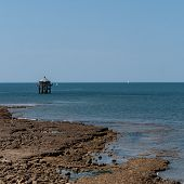 The Lighthouse At The End Of The World In La Rochelle Is A Lighthouse In Front Of The Pointe Des Min poster