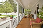 stock photo of screen-porch  - upscale porch with furniture - JPG