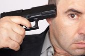 stock photo of gun shot wound  - Suicide concept  - JPG