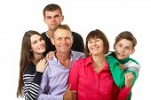 Happy big caucasian family having fun and smiling over white background. Mother, father and children - daughter with her husband and son teenager