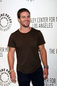 LOS ANGELES - SEP 8:  Stephen Amell arrives at the CW Fall Preview of