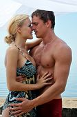 Beautiful Woman And Man Kissing At The Beach.