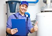 picture of pipefitter  - Smiling technician servicing an hot - JPG
