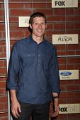 LOS ANGELES - SEP 10:  Zach Gilford arrives at the FOX Eco-Casino Party 2012 at Bookbindery on Septe
