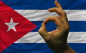 Ok Gesture In Front Of Cuba National Flag