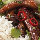 Pork spareribs with rice and vegetables.