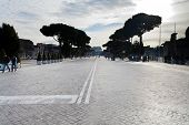 Via Dei Fori Imperiali And View Of Coliseum In Rome