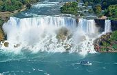 stock photo of fall day  - Niagara Falls closeup panorama in the day over river with rocks and boat - JPG