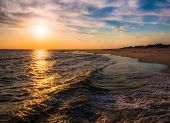 pic of atlantic ocean  - The sun setting over the Atlantic Ocean Cape May New Jersey - JPG