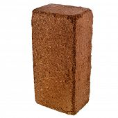 stock photo of coir  - A compressed bale of ground coconut shell fibers  - JPG