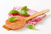 raw minced burger on a wooden spoon and dishtowel