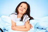 pic of sweet dreams  - Sweet little girl is going to sleep in a bed - JPG