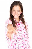 Hispanic girl wearing pajamas and pointing a finger at the camera (isolated on white)