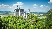 stock photo of bavarian alps  - The fairytale Castle of King Ludwig the 2nd Neuschwanstein in Bavaria Germany in June 2013 - JPG