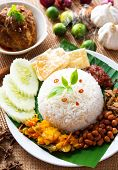 stock photo of ayam  - Nasi lemak traditional malaysian spicy rice dish - JPG