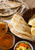 Indian meal, Chapati flatbread, roti canai, dal, curry, teh tarik or pulled tea, acar. Famous indian food.