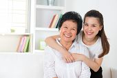 Senior woman and daughter. Happy Asian family senior mother and adult offspring having fun time at h