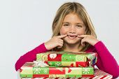 foto of missing teeth  - A little girl in a studio environment with presents missing her two front teeth - JPG