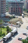 ALANYA - JUL 9: Truck brought concrete for construction building, Jul 9 2012 Alanya Turkey. EU has declared that he is ready to invest 6.6 billion euro to economy of cities Turkeys Mediterranean coast