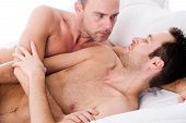 image of gay couple  - Happy homo couple in a white bed taking care of his boyfriend - JPG