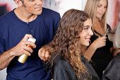 picture of hairspray  - Hairdresser fixing woman - JPG
