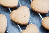 Close Up Of Freshly Baked Heart Shaped Cookies