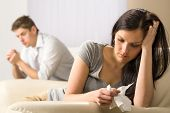 stock photo of sorrow  - Young couple mad at each other in their home - JPG