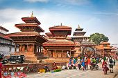 KATHMANDU, NEPAL-MAY 19: Crowd of local Nepalese people visit the famous Durbar square on May 19, 20