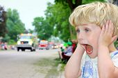 Child Covering Ears At Loud Parade