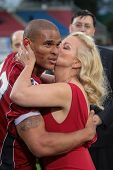 VADUZ, LIECHTENSTEIN - JULY 21 DB DJ Wolfe (#32 Broncos) is kissed by Shawne Fielding on July 21, 20