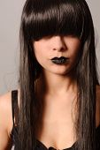 Young mysterious fashion woman with black hairs