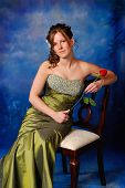 image of senior prom  - Portrait of a pretty high school graduate in prom dress - JPG