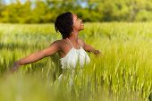 stock photo of brazilian food  - African American woman in a wheat field  - JPG