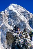 NEPAL - MARCH 2010: Unknown people standing on the top of the Kala Patthar Mountain near Mount Everest Base Camp in the Himalayas, Nepal.