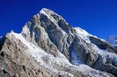 Pumori Mountain against blue sky. Pumori (or Pumo Ri) is a mountain on the Nepal-Tibet border in the