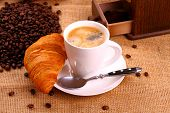 Coffee In White Cup And Croissant