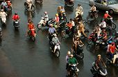 Group Of People Ride Motorbike In Rush Hour