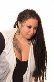 stock photo of curvaceous  - Beautiful ethnic curvaceous woman with long dreadlocks tattoos and piercings on a white background - JPG