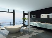 Expensive luxury bathtub against panoramic window with seascape view