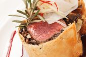 stock photo of beef wellington  - Fillet Wellington with fresh herbs - JPG