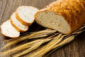 image of fresh slice bread  - Fresh white sliced bread lying on table - JPG