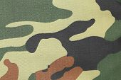 foto of camoflage  - Camouflage texture pattern with green tones - JPG