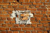 picture of divergent  - Naturally aged brick wall repaired with divergent pieces - JPG
