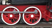 Two Locomotive Wheels Of Red Color