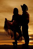 Silhouette Cowboy Couple Hold Skirt Up